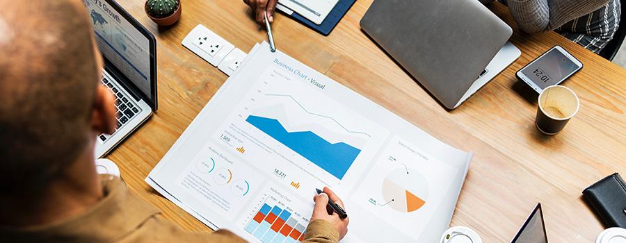 Data and analytics from a cannabis marketing campaign on a desk. Cannabis marketing and SEO company. Marijuana Dispensary SEO agency.
