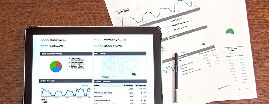 Tablet showing Google Analytics stats and reporting documents on a desk. SEO for cannabis companies and medical marijuana companies. Marijuana Dispensary SEO. Marijuana marketing agency Canada and USA.