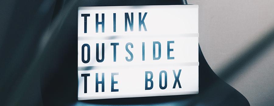 "Sign that reads ""Think outside the box"". Marijuana marketing ideas. Cannabis marketing and dispensary advertising. Medical marijuana marketing ideas."
