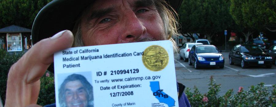 Man holding a MMJ ID card to the camera. Medical marijuana marketing strategy. MMJ Marketing Agency Canada USA.