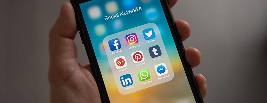 Social network icons on a smartphone screen. Cannabis social media management tips and ideas. Cola Digital Cannabis Marketing Agency Canada and USA. ColaDigital.ca. Dispensary marketing.