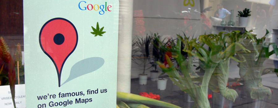 Picture of a Google local pin in a cannabis retail store window. Dispensary SEO tips from Cola Digital Cannabis Marketing Company Canada and USA. ColaDigital.ca.