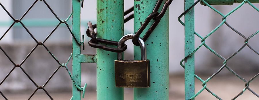 Padlock and chain locking a green fence. Dispensary SEO tips say HTTPS websites are best. Dispensary SEO Strategy from Cola Digital Cannabis Marketing Company Canada and USA. ColaDigital.ca.