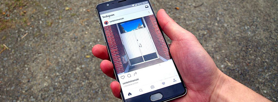 Hand holding smartphone with Instagram screen. Dispensary marketing strategy. Dispensary marketing tips. How to promote a dispensary on Instagram.