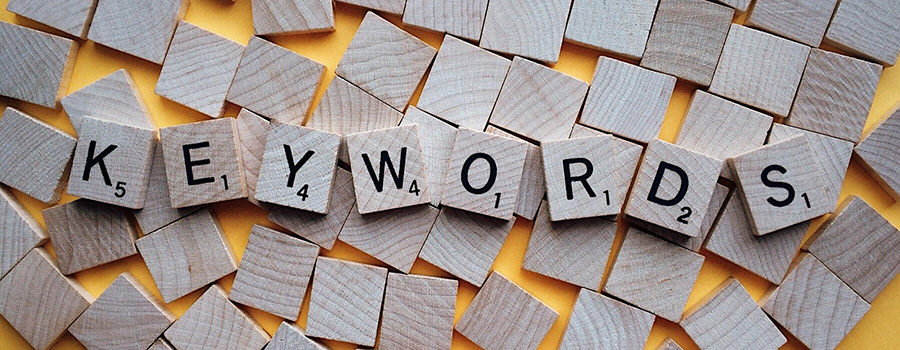 "The word ""keywords"" spelled out in scrabble tiles. Dispensary SEO Tips and strategy. Cola Digital Cannabis Marketing Agency."