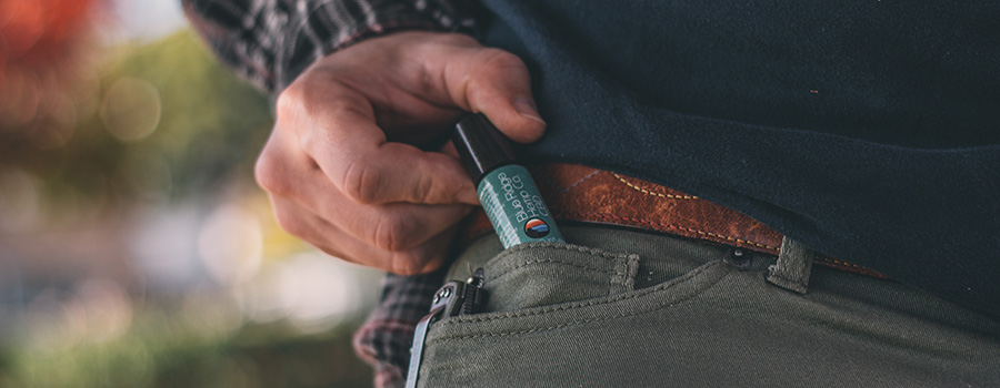 Man pulling CBD product from his front pocket. Best tips to sell CBD online. Marketing ideas for CBD on Facebook. Advertise CBD with Google PPC advertising.