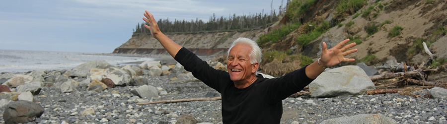 Baby boomer man smiling with arms stretched out above his shoulders. How to market and promote a dispensary. Dispensary marketing tips. Dispensary marketing strategy. Social media marketing for dispensaries. Dispensary marketing agency.