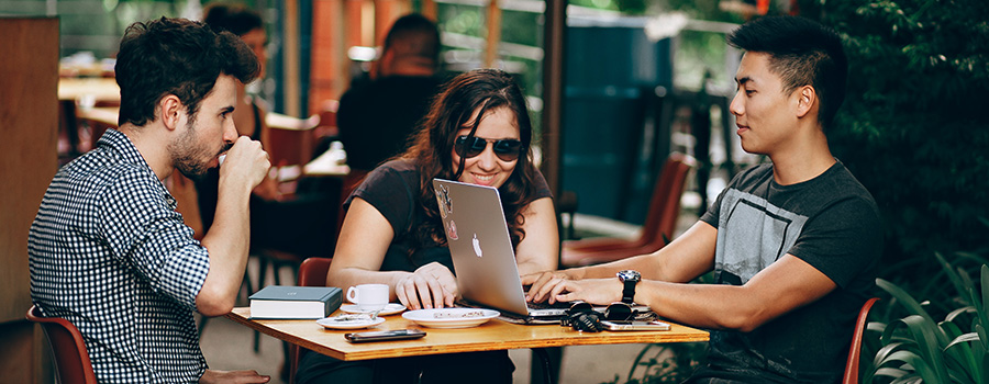Millennials at a coffee shop on their laptops. How to market your dispensary to millennials. Dispensary marketing tips. Dispensary marketing agency.