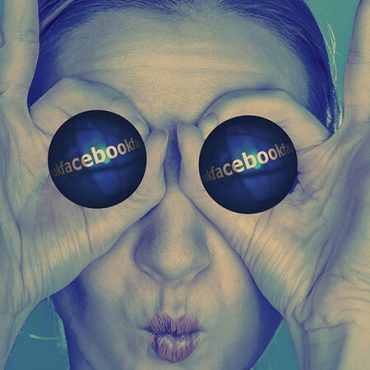 Girl making circles around eyes with hands. Cannabis marketing on Facebook. Cannabis marketing services. Marijuana marketing agency.