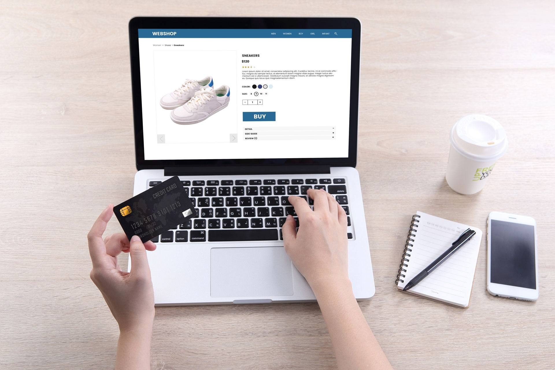 Hands on a laptop, using a credit card to shop online.eCommerce website development company for marijuana and cannabis businesses. web design and online store development.