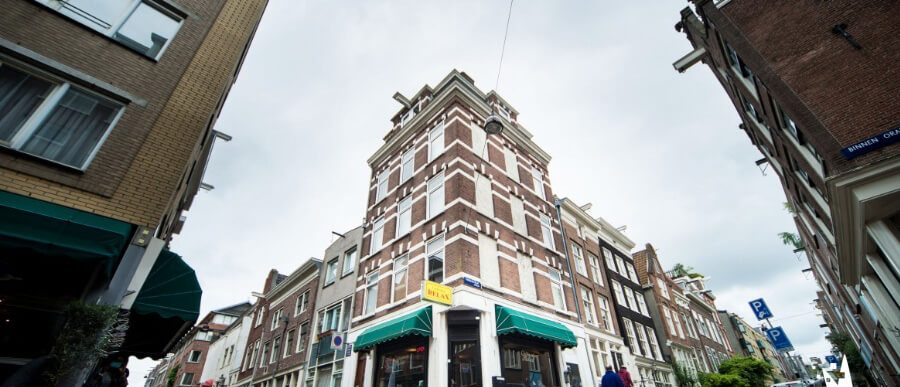 Street corner and marijuana dispensary building in Amsterdam. Local SEO tips for marijuana dispensaries. SEO for dispensaries. SEO for marijuana dispensaries. Cannabis marketing Agency.