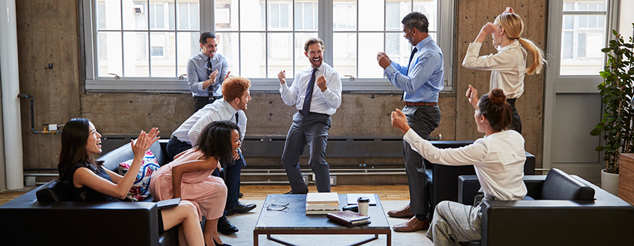 Cannabis marketing team celebrating in office.