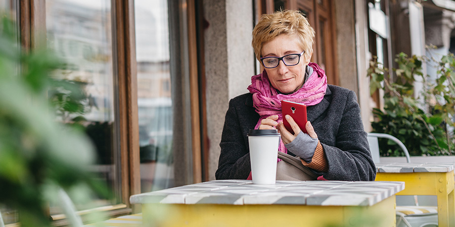 adult woman with coffee and smartphone. Hemp marketing and SEO agency. CBD advertising company.
