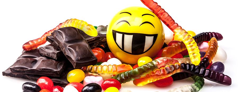 Selection of THC edibles and a happy face emoji. Marijuana SEO company. Cannabis marketing and SEO agency USA and Canada.