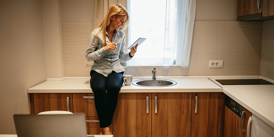 woman reading cbd blog article on tablet. Blog content writing services for cbd companies. hemp cbd marketing agency Canada and USA.