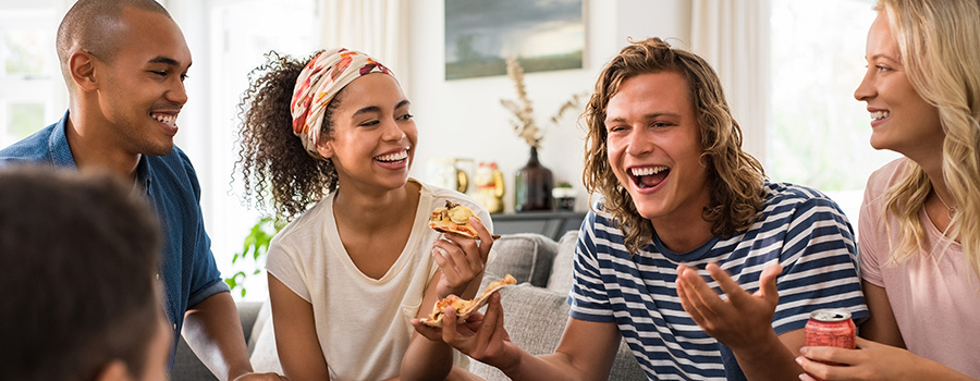 friends enjoying a pizza party. cannabis marketing and seo services.