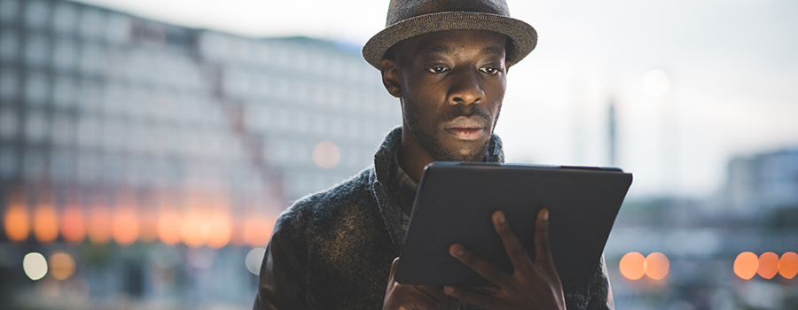 young handsome afro black man on a tablet. CBD email marketing agency.