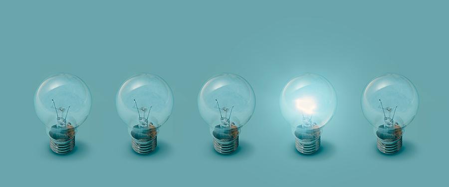 one lit bulb next to unlit bulbs. cbd marketing ideas.