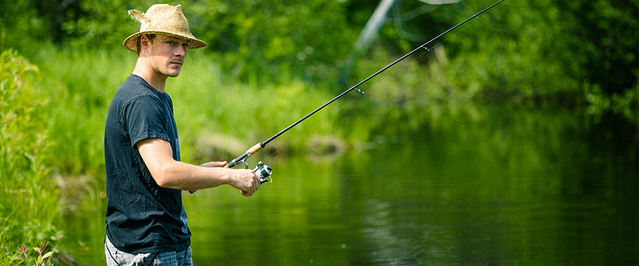 young fisherman fishing with patience. marijuana marketing agency.