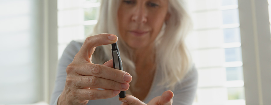 active senior diabetic woman testing blood. dispensary SEO agency.