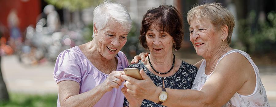 senior women using marijuana and looking at photos on phone.