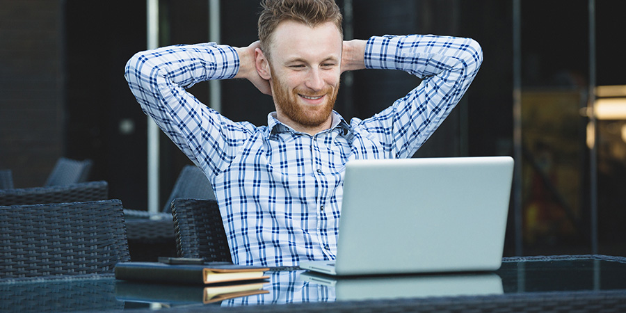 handsome businessman working with laptop. cbd advertising services.