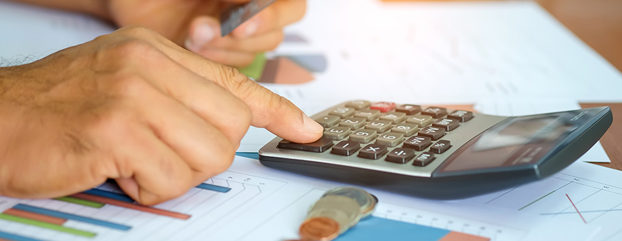 man using a calculator to analyze cbd industry USA. facebook advertising for hemp cbd products.