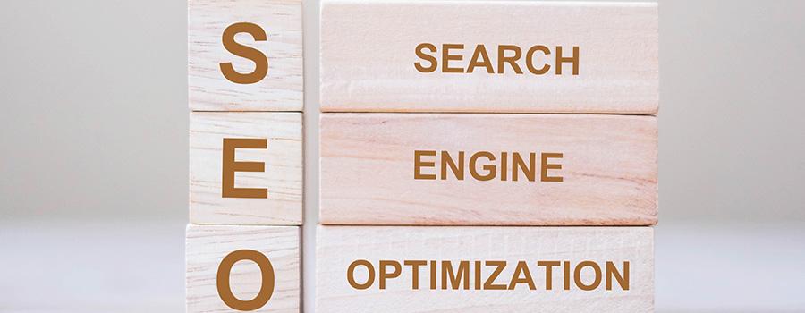 seo search engine optimization text wooden cube. cannabis website design and development agency. CBD SEO company.