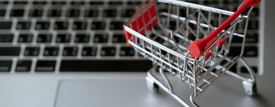 shopping cart on laptop cbd and cannabis website development agency. marijuana website design and seo.