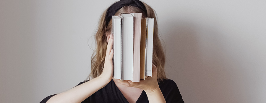 the-woman-covers-face-with-books-concept-cbd-marketing-company